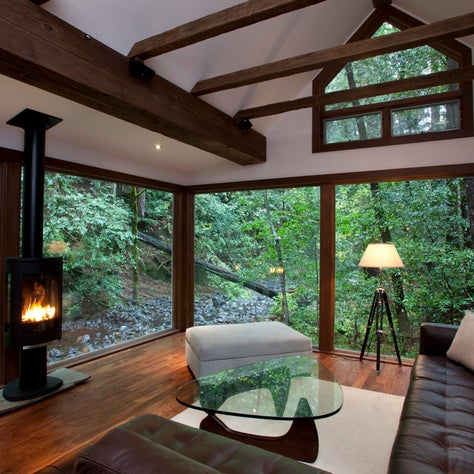 Creekside Cabin:  A new all glass addition with deep wood trim and collar ties, connect to the Creekside view