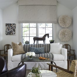 fun, eclectic family room infused with souvenirs, heirlooms, and family lore