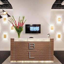 Philadelphia Showroom Design with Custom Front Desk and Wall Mounted Lighting