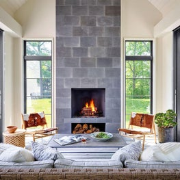 Indoor-Outdoor Living, Three-Seasons Room, Retractable Glass Walls, Wood-burning Fireplace, Cowhide Chairs, Grey Stone - Glencoe Contemporary Project