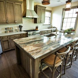Rustic, farmhouse kitchen, stone island, bar stools, pendant lights, wood floor