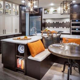 Kitchen remodel with floor to ceiling storage and colorful breakfast banquette
