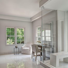 A mix of natural stones and high end Italian porcelain was used for this bathroom.