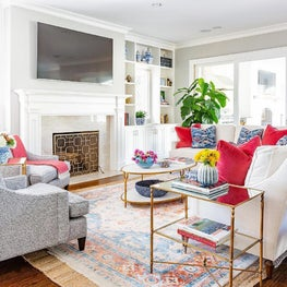Transitional family room with fireplace