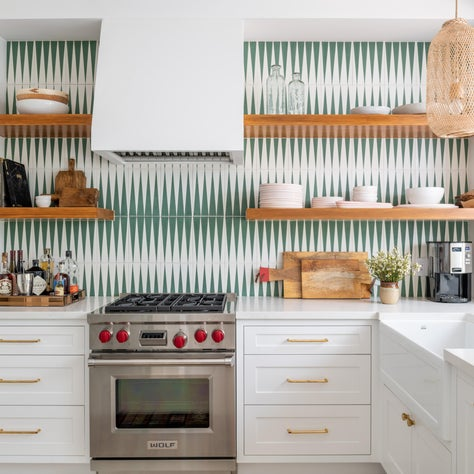 A Bright Kitchen with Open Shelving and Green Patterned Tiles
