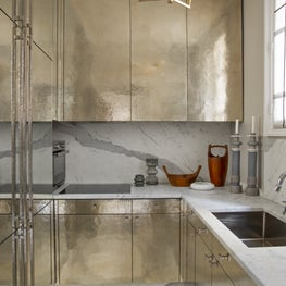 Paris pied à terre kitchen with custom Deniot hammered silver cabinetry