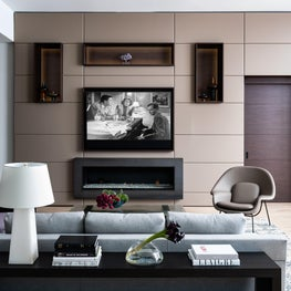 Modern Family Room with Lighted Cabinetry