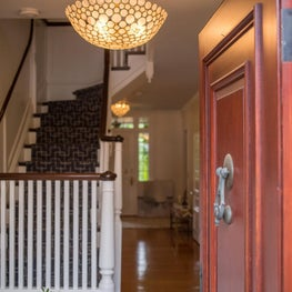 Entry in historic home with shell bowl chandelier and bench-Sophia Shibles