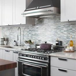 Back Bay Kitchen with glass tile backsplash and light gray cabinetry