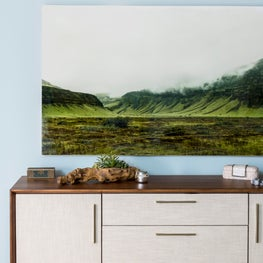 Bedroom vignette oversized photograph art landscape linen mid-century dresser