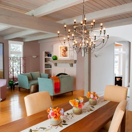 Post + Beam Great Room, 2097 chandelier, lighthouse painting, sunrise colors.