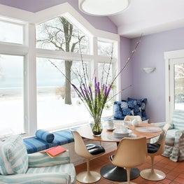 Breakfast Lounge banquette, Saarinen tulip chairs, sunrise colors + coastal view