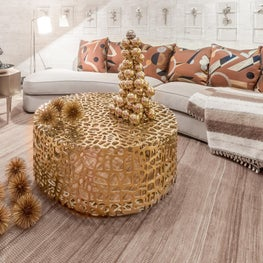 Festive room with a curved sofa created for a holiday house