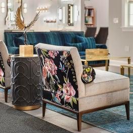 Philadelphia showroom design with contrast fabrics on glamorous slipper chairs
