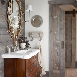 Montana cattle ranch guest house master bath with antique vanity and mirror