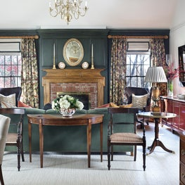 Casual Elegance, Green  paneling,coral lacquer cabinet, antique lamps,brass