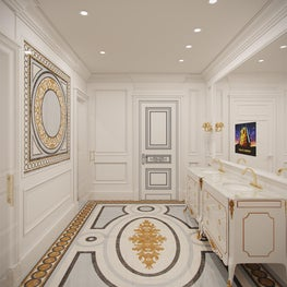 Crema marfil  walls accent a floor medallion crafted of multiple marbles.