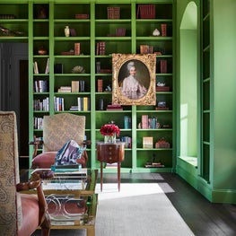 Library Featuring Green Painted Bookshelves