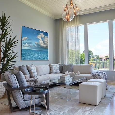 Elegant Golf Manor Sitting Room - Family Room overlooking golf course. Custom light fixture, bold art, faux fur throw, luxurious fabrics.