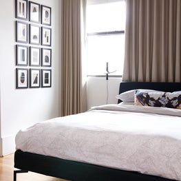 Modern guest room with contemporary art wall featuring the works of Josh Young
