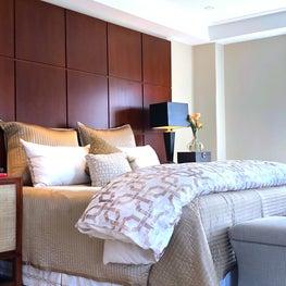Elegant transitional master bedroom with custom headboard