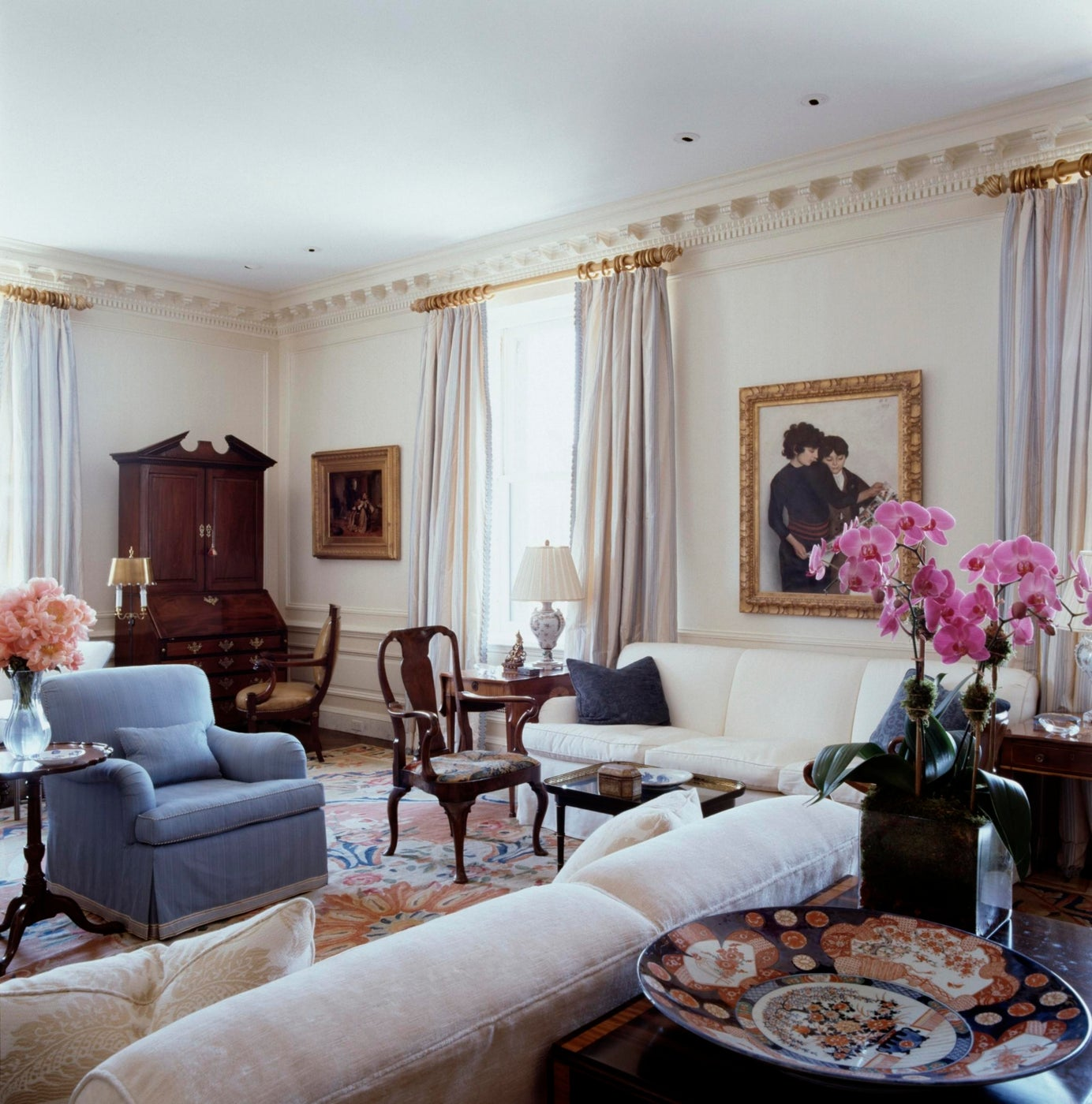 A completely renovated prewar livingroom with paneling and plaster cornices