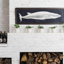 White Washed Fireplace with Whale Art on Mantle