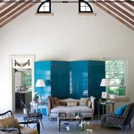 Living room with blue lacquer screen and European antiques in a Hampton's summer house
