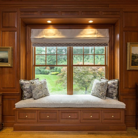 New Canaan Ct Paneled Library,Custom Window Seat, Oil Paintings, Decorative Pillows in Muted Browns and Greens