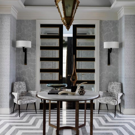 5th Ave Entryway in shades of gray with geometric marble floors and Deniot table