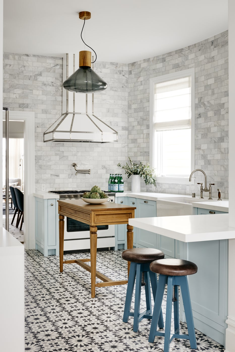 Light blue transitional kitchen with patterned tile floors and white appliances