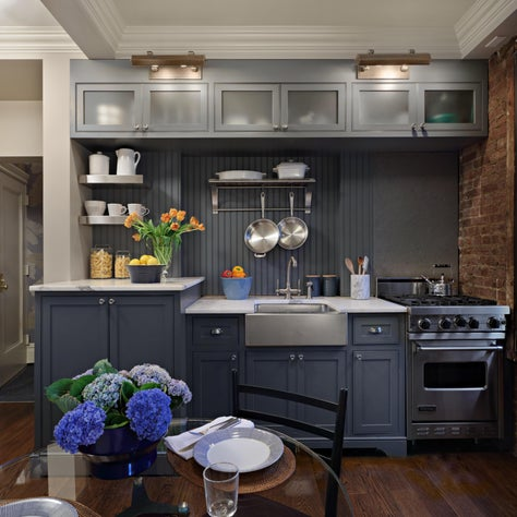 A slate blue painted wooden bead board acts as an unexpected back splash