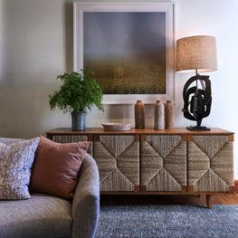 A raffia chest evokes the natural materials used throughout this home.