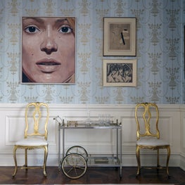 Greenwich Whimsy: colorful custom rug, gold vintage chairs, bar cart and art