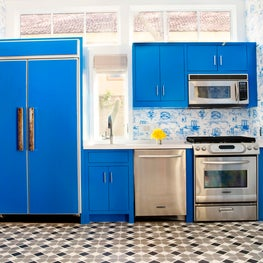 Pool House kitchen with blue gloss cabinetry, cement tile and toile wallpaper