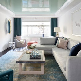 Upper East Side Living Room with green lacquered ceiling and salmon pink pouf