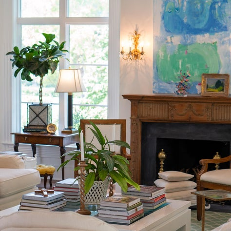 Beautiful collected family room with antique mantle and contemporary art