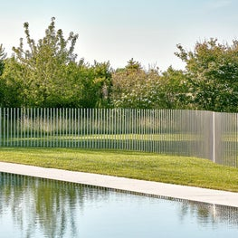 A sinuous, contemporary twist on a pool fence