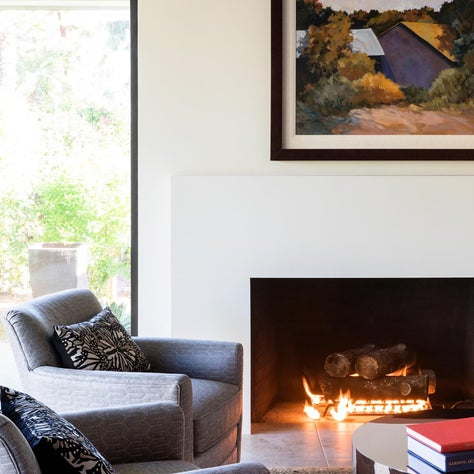 Swivel chairs and cozy modern fireplace in Rancho Mirage