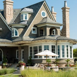 Ocean Front Elevation with Covered Porch, Raised Patio and Brick Chimneys