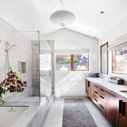 Master Bath with subtle gray-green veined quartzite surfaces