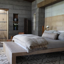 Natural colors and textures create the palette for a master bedroom