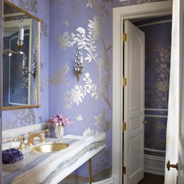 Chic powder room with colorful marble vanity and purple wallpaper