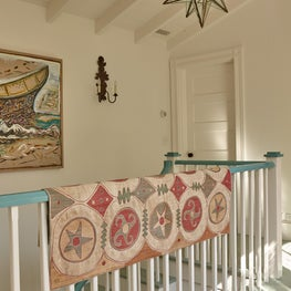 Painted staircase detail with antique rag rug.
