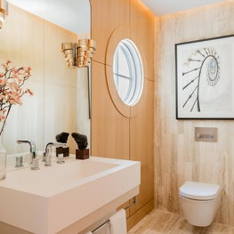 Wellesley Family Home, Powder Room with oak paneling, travertine, Art Deco vibe