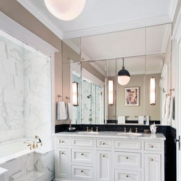 Classic Bathroom with Checked Floor and Brass Fixtures, Mirrored Wall