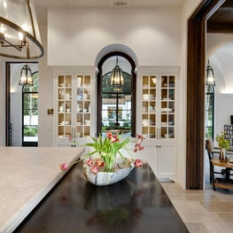 Spanish Colonial Equestrian Estate, limestone countertop, white cabinetry with glass shelving