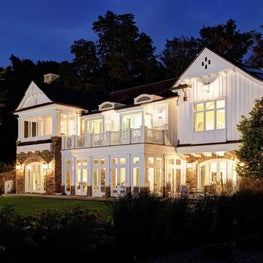 Michigan Lake House - rear façade with traditional dormers, corbels, and vents