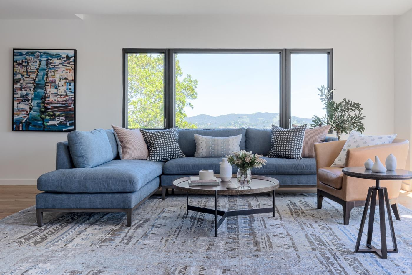 Modern Living Room with Soft Blue Sectional and a View