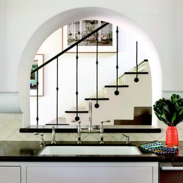Interior arched picture window in kitchen, looking onto staircase